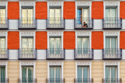 Apartment balconies line the streets of Madrid, Spain.