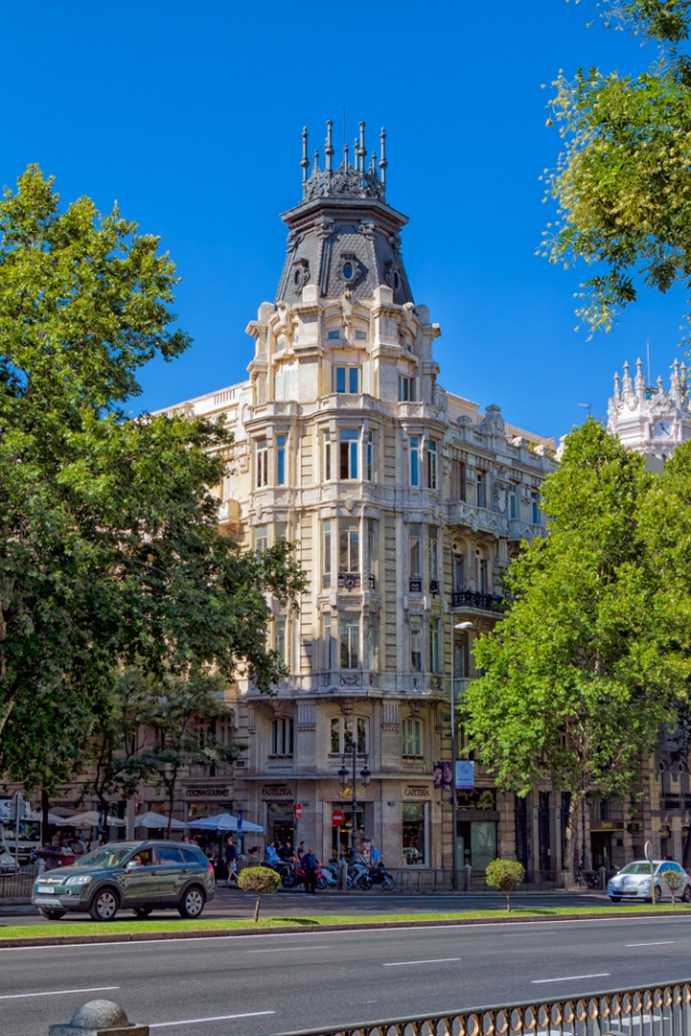 Beautiful building housing apartments and shops on the Northwest corner of Calle de Serrano and Calle de Hermosilla in Madrid, Spain.