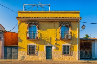Bright yellow home located on the commercial street in Los Hueros, Spain